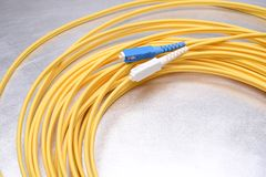 Optical patch cord single mode SC. On metal background Royalty Free Stock Images
