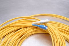 Optical patch cord single mode SC. On metal background Stock Photo