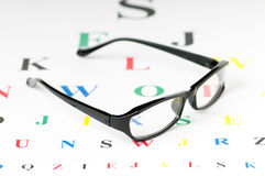 Optical reading glasses on the table. Optical reading glasses on the eyesight table stock photography