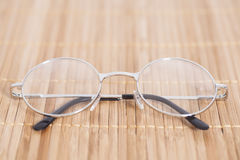 Optical round glasses. On wooden background royalty free stock photos