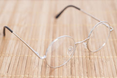 Optical round glasses on wooden. Background stock photo