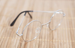 Optical round glasses on wooden. Background royalty free stock photo