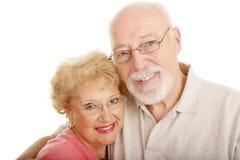 Optical Series - Seniors Closeup. Senior couple wearing glasses.  White background Stock Photography