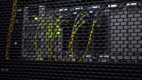 Optical server is located behind the iron door of the data center server room. View through the round vents of the. Cabinet wall stock footage
