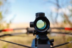 Optical sight crossbow. Aiming from the first person on the background of the lake. Male ohotitsya wild animals in summer forest Royalty Free Stock Image