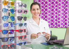 Optical store, people and lenses. Stock Photos