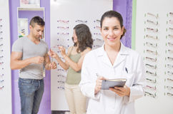 Optical store, people and lenses. Stock Image