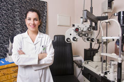 Optical store, people and lenses. Optometrist chair, ophtalmology diopters calibration in oculist lab of young woman doctor Royalty Free Stock Photos