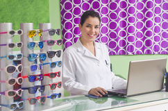 Optical store, people and lenses. Royalty Free Stock Images