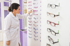 Optical store, people and lenses. Royalty Free Stock Photos