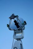 Optical telescope on blue sky Royalty Free Stock Photos