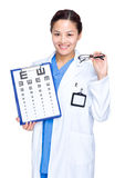 Optical woman doctor with eye chart and glasses Royalty Free Stock Images