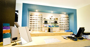 Opticial salon counter. Counter of optician salon with glasses on display Stock Images
