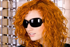 At optician. Young attractive girl wearing sunglasses at the optician Stock Photo