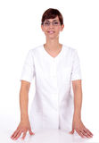 Optician. Nurse in white with hands on table wearing glasses stock images
