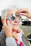Optician adjusting trial frame for Royalty Free Stock Photo