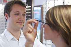 Optician Advising Client On Choice Of Glasses Royalty Free Stock Image