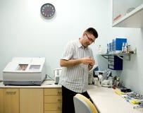 Free Optician At Work. Royalty Free Stock Photos - 2310328