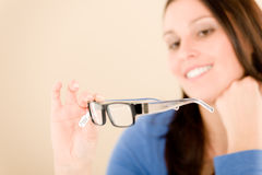 Optician client choose prescription glasses Royalty Free Stock Photos