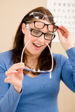 Optician client choose prescription glasses Stock Images