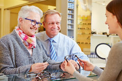 Optician consulting senior couple Stock Images