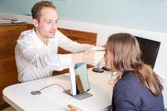 Optician customizes glasses Stock Image