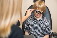 Optician Determining Prescription Values With Stock Image