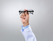 Optician doctor hold with eye glasses Stock Photography