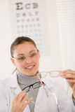 Optician doctor woman with glasses and eye chart Royalty Free Stock Image