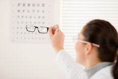 Optician doctor woman with glasses and eye chart Stock Photo