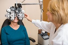 Optician Examining Patient's Vision Royalty Free Stock Photography