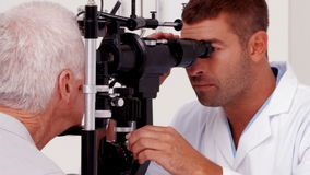 Optician examining a patients eyes