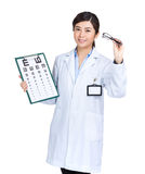 Optician with eye chart and glasses Royalty Free Stock Photos