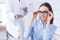 Optician with eyeglasses and client Stock Images