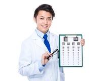 Optician with eyesight test and eyewear Stock Photography