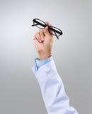 Optician hand with eye glasses Stock Image
