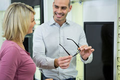Optician helping customer for selecting a spectacles frame Stock Photo