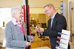 Optician helping senior woman Stock Photos