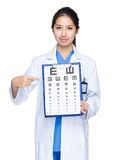 Optician point to eye chart Stock Photo
