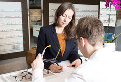 Optician prescribing new glasses Stock Photos