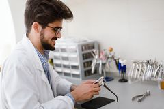 Optician repairing and fixing eye glasses Royalty Free Stock Photo