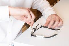 Optician repairs eyeglasses Stock Image