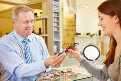 Optician selling glasses Royalty Free Stock Images