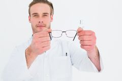 A optician showing glasses next to an eye test Royalty Free Stock Photos