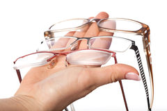Optician showing glasses to customer Stock Photography