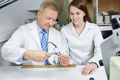 Optician teaching apprentice Stock Images