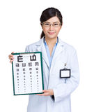 Optician woman showing eye exam chart Stock Image