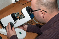 Optician in the work, the production Stock Images