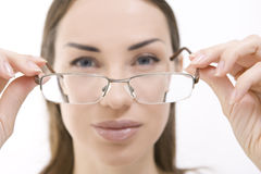 Optics and Glasses, Portrait of young smiling woman looking thro Royalty Free Stock Photo