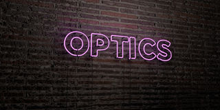 OPTICS -Realistic Neon Sign on Brick Wall background - 3D rendered royalty free stock image Royalty Free Stock Image